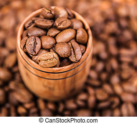 Fresh aromatic coffee beans in a wooden cup