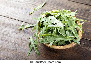 Fresh arugula leaves, rucola, fresh rucola  in a plate, space for text.