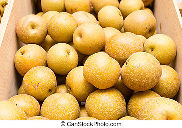 Fresh asian pears in wooden crate