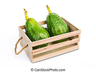 Fresh avocado fruit in wooden crate.