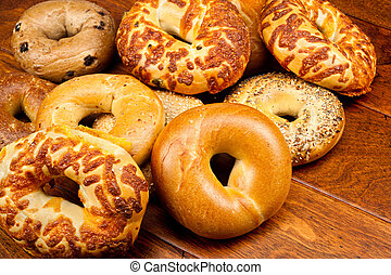 An assortment of fresh bagels on a wooden table