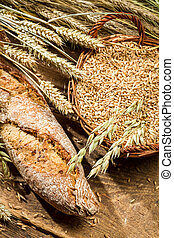 Fresh baguette with cereal grains in a basket