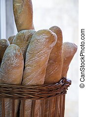 Fresh baguettes in a basket