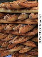 Fresh baguettes, traditional French bread at a market
