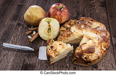 Fresh baked Apple Cake on wooden background