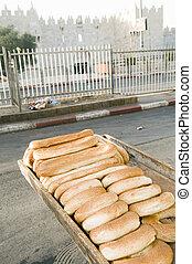 fresh baked bageleh bread Jerusalem street market view of Damascus Gate Old City Israel Asia