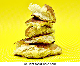 fresh baked bread isolated on yellow background