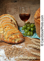 fresh baked bread, wine and grapes