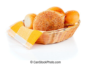fresh baked buns in a basket on white background