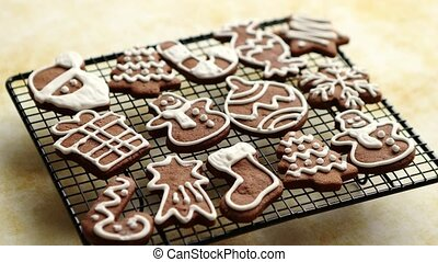 Fresh baked Christmas shaped gingerbread cookies placed on...