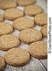 Fresh baked oat cookies closeup on rustic wooden table background.