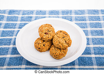 Fresh baked oatmeal cookies with raisins, cranberries and nuts