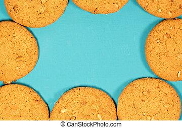 Fresh baked peanut cookies on rustic background