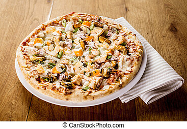 Fresh Baked Seafood Pizza on Wooden Table