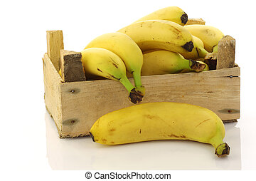 fresh bananas in a wooden crate