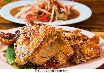Fresh barbecue chicken,Thai papaya salad and vegetable on the table