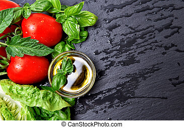 fresh basil herbs and tomatoes with olive oil