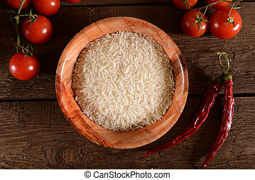 Fresh basmati rice in bamboo bowl