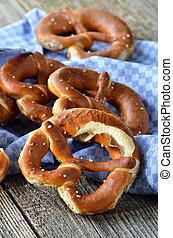 Fresh Bavarian pretzels on an old wooden table