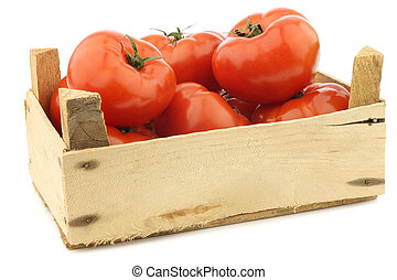 fresh beef tomatoes in a wooden crate