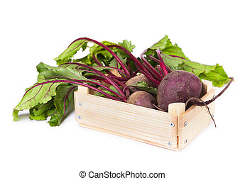 Fresh beets in a wooden box