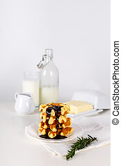 Fresh Belgian waffles with chocolate white wooden background. selective focus.