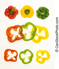 Fresh bell peppers and sliced rings, isolated on white background.