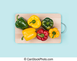 Fresh bell peppers on a chopping board