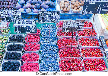 Fresh berries and fruit at the market stall