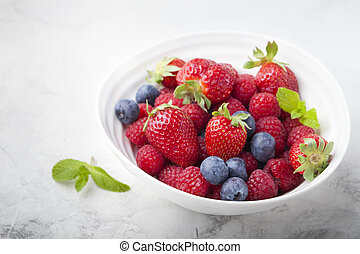 Fresh berries, blueberry, strawberry, raspberry with mint leaves