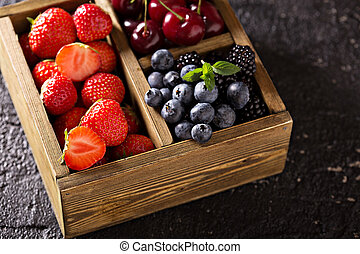 Fresh berries in a wooden crate