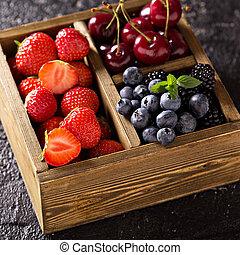 Fresh berries in wooden box