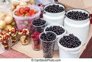 Fresh berries of new harvest ready to sale at the local farmers market