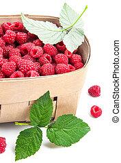 Fresh berries raspberry in wicker basket