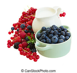 resh berries with jug of milk isolated on white background