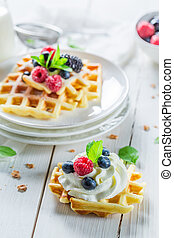 Fresh berries with waffels for breakfast