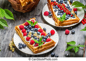 Fresh berry fruit on waffels