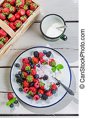 Fresh berry fruits with cream