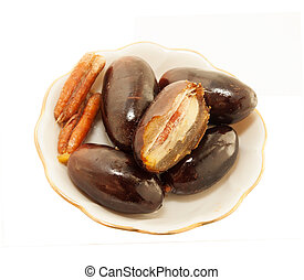 Fresh big dates  in sauce isolated on white background. close up