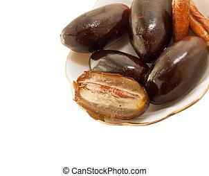 Fresh big dates  isolated on white background. close up