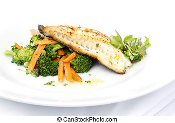 Fresh black cod on bed of broccoli and carrots