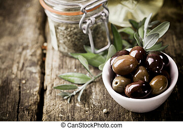 Fresh black olives and herbs - A bowl of fresh black olives...