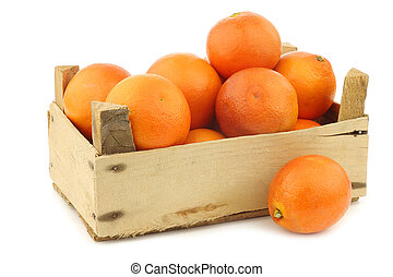 fresh blood oranges in a wooden crate