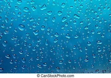 Close up of fresh blue drops of water