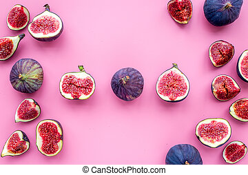 Fresh blue figs on pink background top view copyspace
