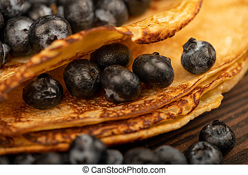 Fresh blueberries and traditional Russian pancakes. Shrovetide week of the end of winter.