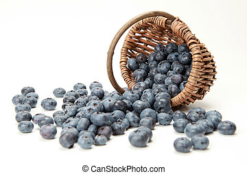 Blueberries - Fresh Blueberries falling out of a basket