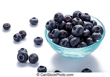 fresh blueberries in a glass bowl