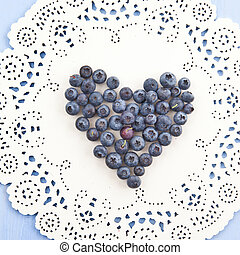 Fresh blueberries in a heart-shape