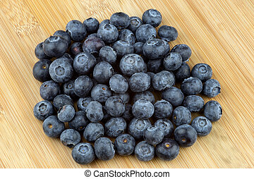 Fresh Blueberries On A Wooden Table Top
